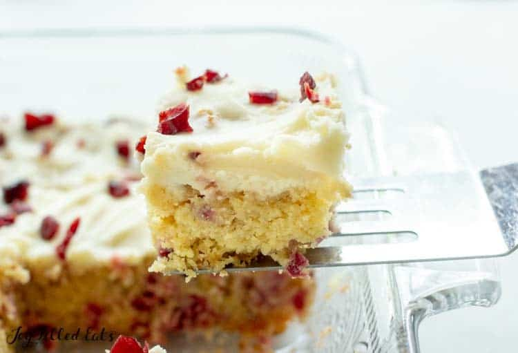 spatula lifting cranberry bliss bar from casserole dish