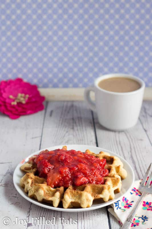 Coconut Waffle with Strawberry Sauce on a white plate