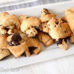 white platter full of dark chocolate crescent cookies