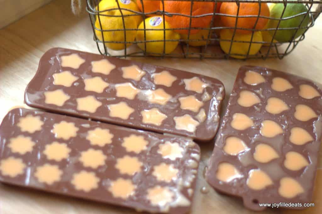 sugar free orange creamsicle gummies formed in various shaped candy molds