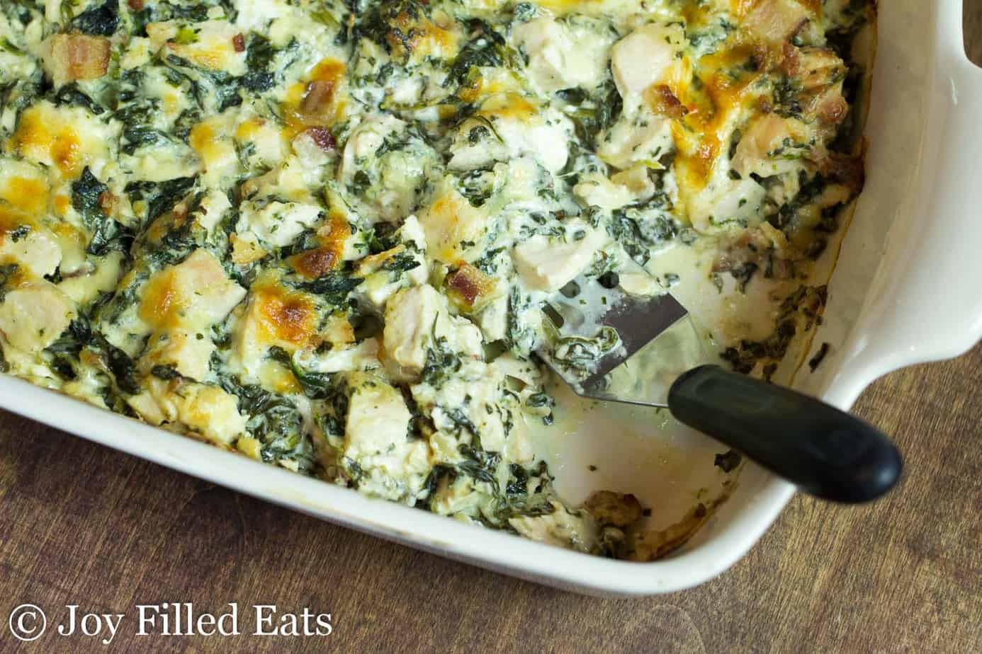 cooked chicken and spinach in a creamy sauce