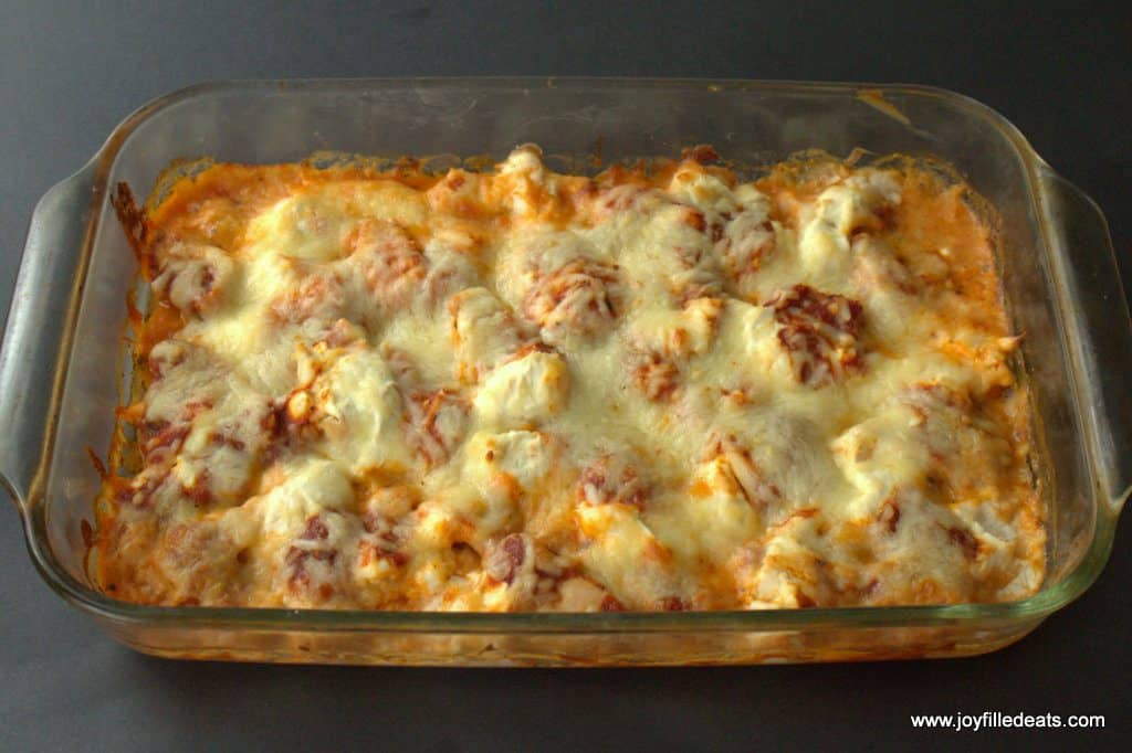 Baked Pizza Chicken Casserole with golden cheese on top.