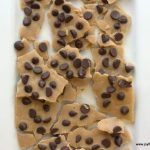 overhead view of low carb chocolate chip cookie dough bark placed on a white platter