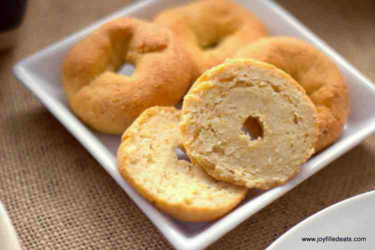 plate of low carb mini bagels with one sliced in half