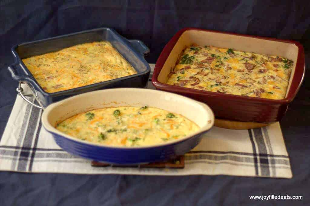 3 different versions on the easy egg bake in casserole dishes on a blue and white placemat