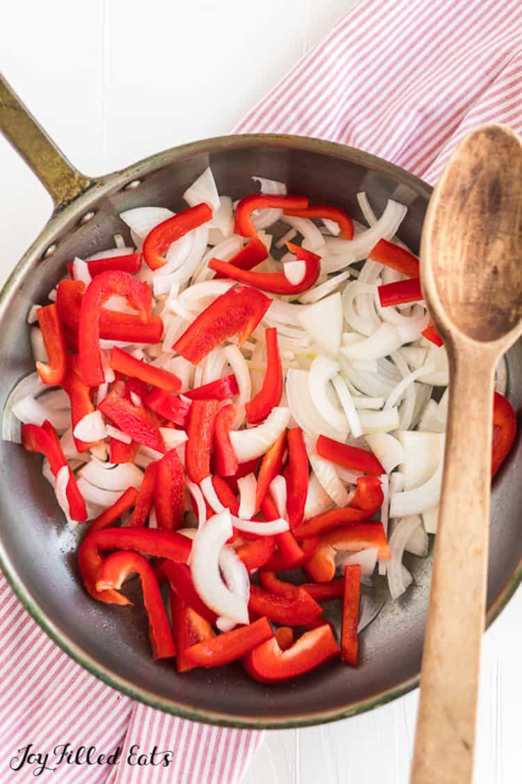 frying pan with peppers and onions