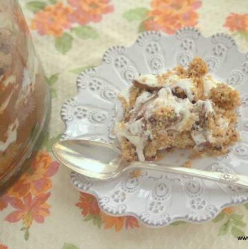 serving of chocolate chip cookie trifle on a white plate with spoon