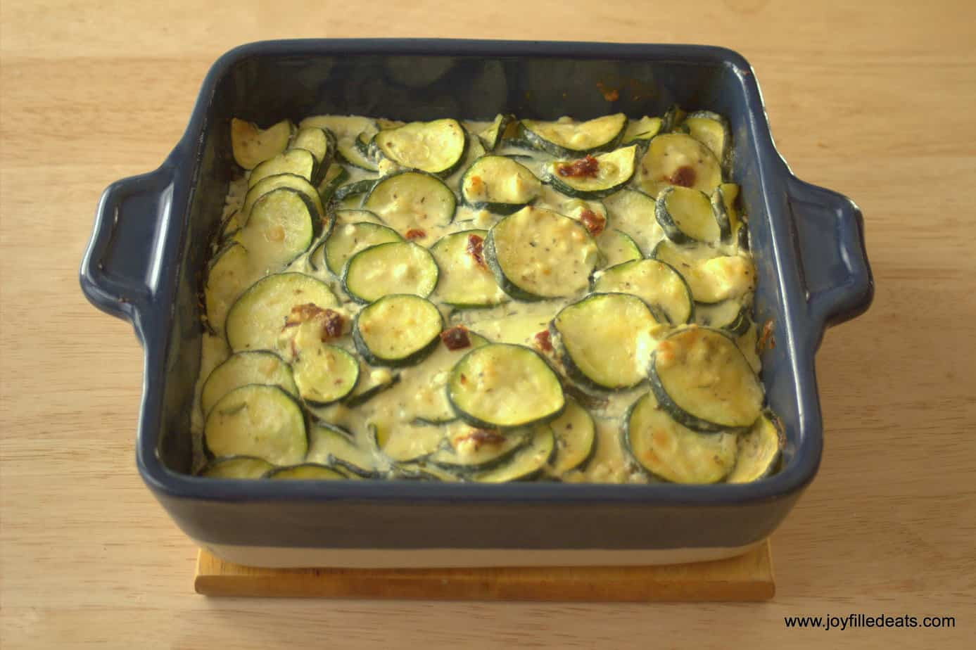 Zucchini Gratin - My baked zucchini gratin has sun-dried tomato and feta cheese which give it a Mediterranean vibe. It is grain free, low carb, and a THM S.