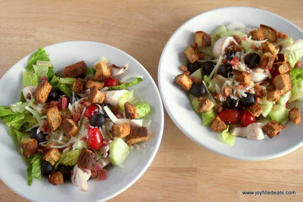 two bowls of salad with gluten free croutons