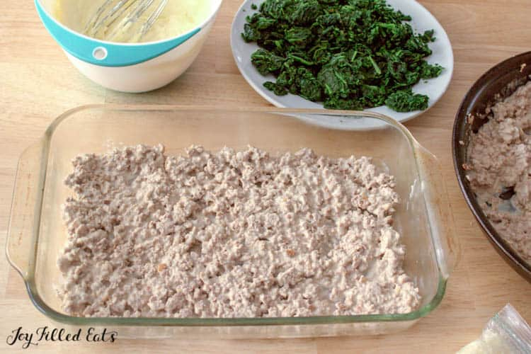 Ground meat layered into casserole dish