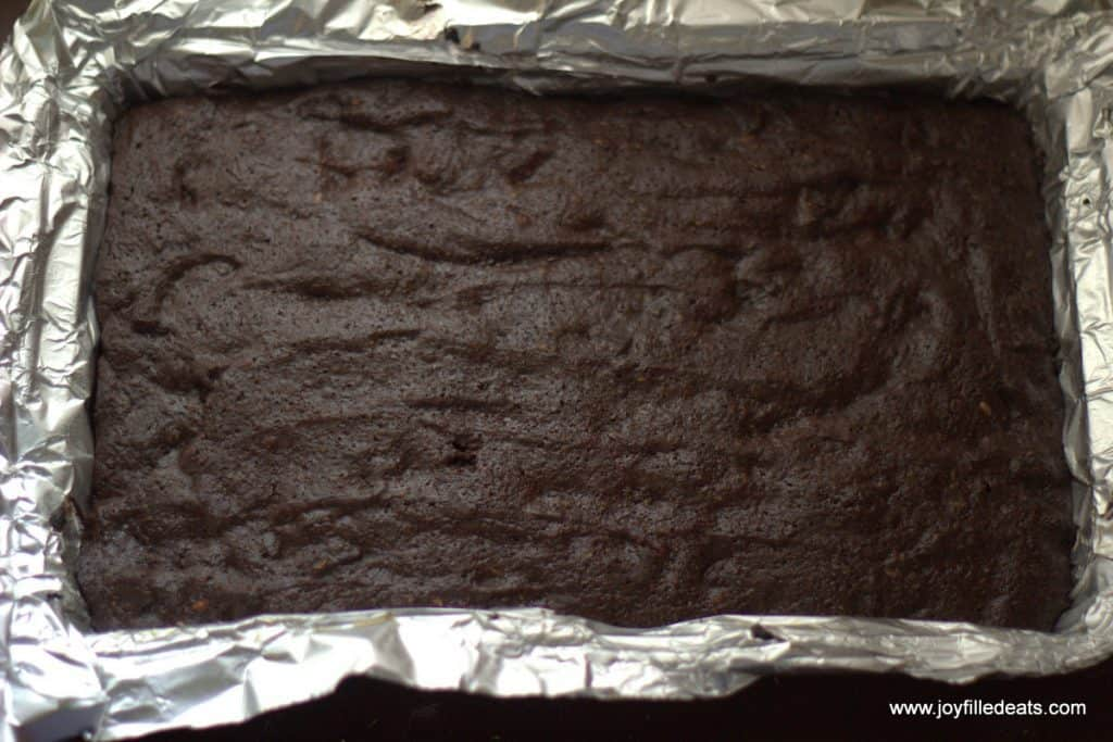 brownies baked into a aluminum foil lined baking dish