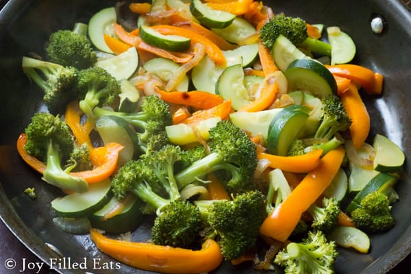 mixed vegetables up close in a skillet