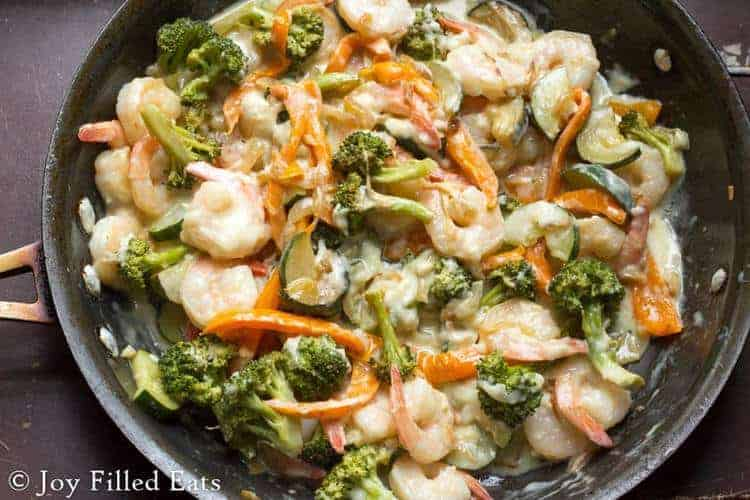 skillet filled with creamy shrimp primavera