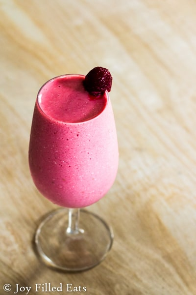 close up on frozen raspberry cheesecake cocktail mocktail