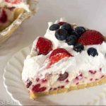 slice of ice cream pie topped with mixed berries