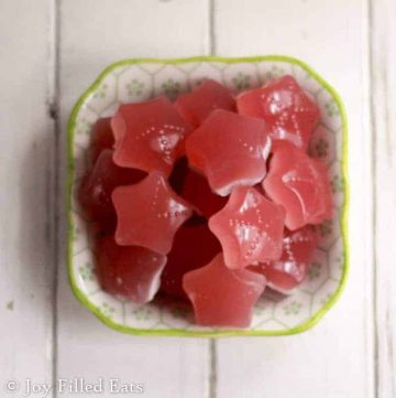 overhead view of three ingredient gummies shaped as stars in a small dish