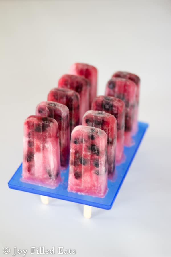 sugar free popsicles standing up in the lid of the ice pop maker