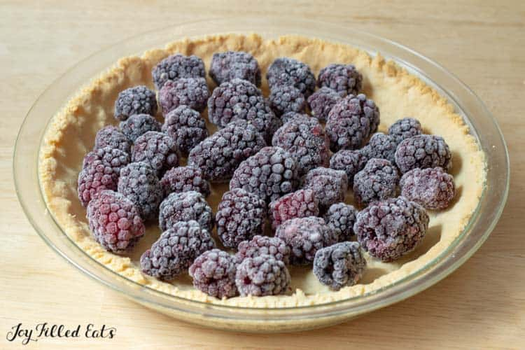 frozen blackberries in the prebaked pie crust