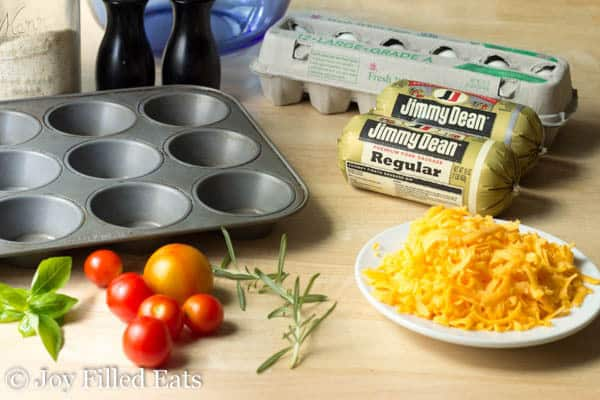 A muffin tin, sausage, eggs, and cheese for the Sausage Egg Muffins.
