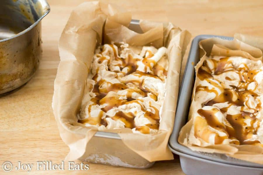 two parchment lined rectangular tins filled with sweet cream coffee caramel ice cream