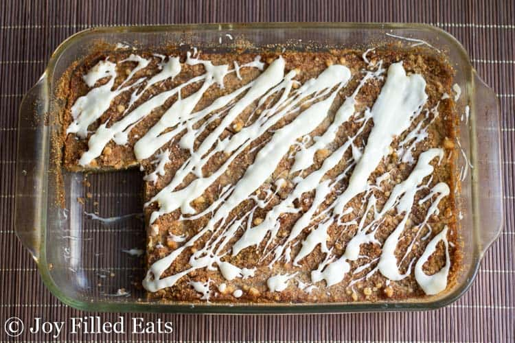 baking dish of pumpkin dump cake with corner piece missing from above