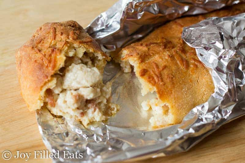 A costco chicken bake on foil broken open to show the filling