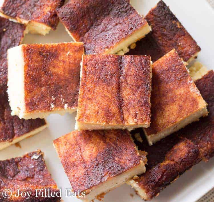 Sopapilla Cheesecake Bars piled on a white plate