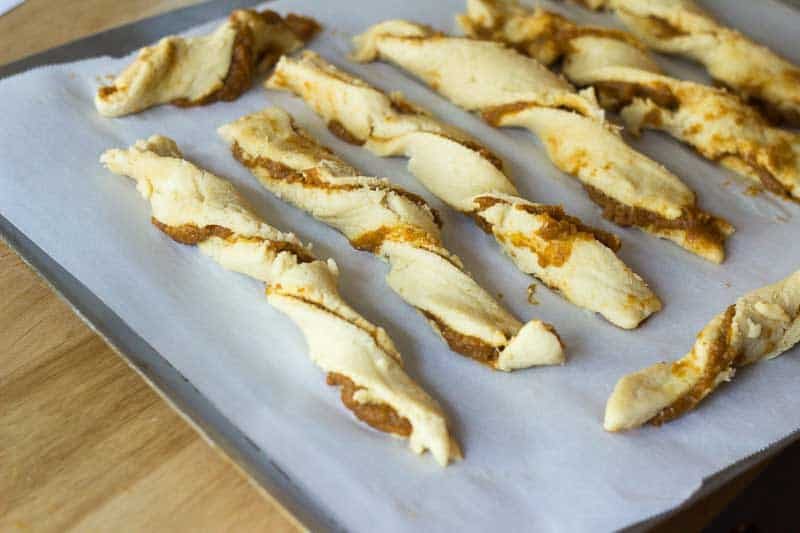 Keto Pumpkin Pie Twists twisted on a baking sheet