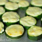 close up on Garlic Parmesan Zucchini pieces on a sheet pan