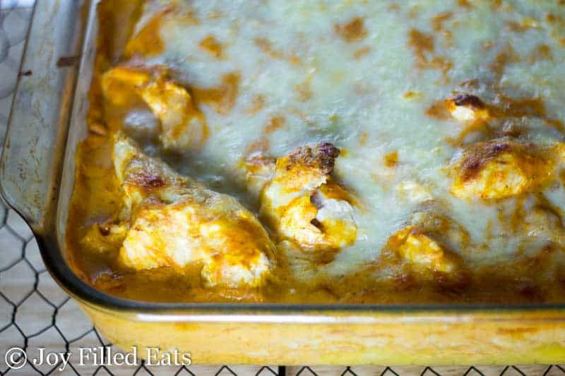 Close up of the Creamy Tomato Chicken & Spaghetti Squash Casserole with browned melted cheese on top