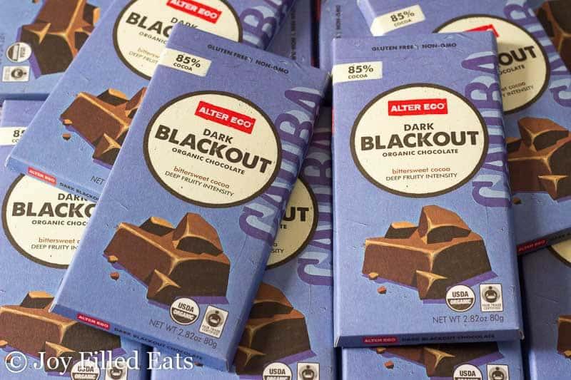 pile of Alter Eco Dark Blackout Organic Chocolate bars