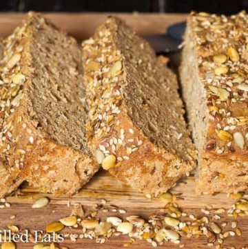 close up on slices and loaf of quinoa bread on a cutting board