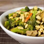 close up on bowl of thai peanut chicken and broccoli