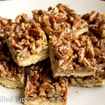 pile of pecan praline cookie bars on a white plate from above