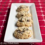 almond crunch chocolate thumbprint cookies lined on a rectangular white platter