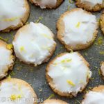 close up of keto iced lemon cookies sprinkled in lemon zest