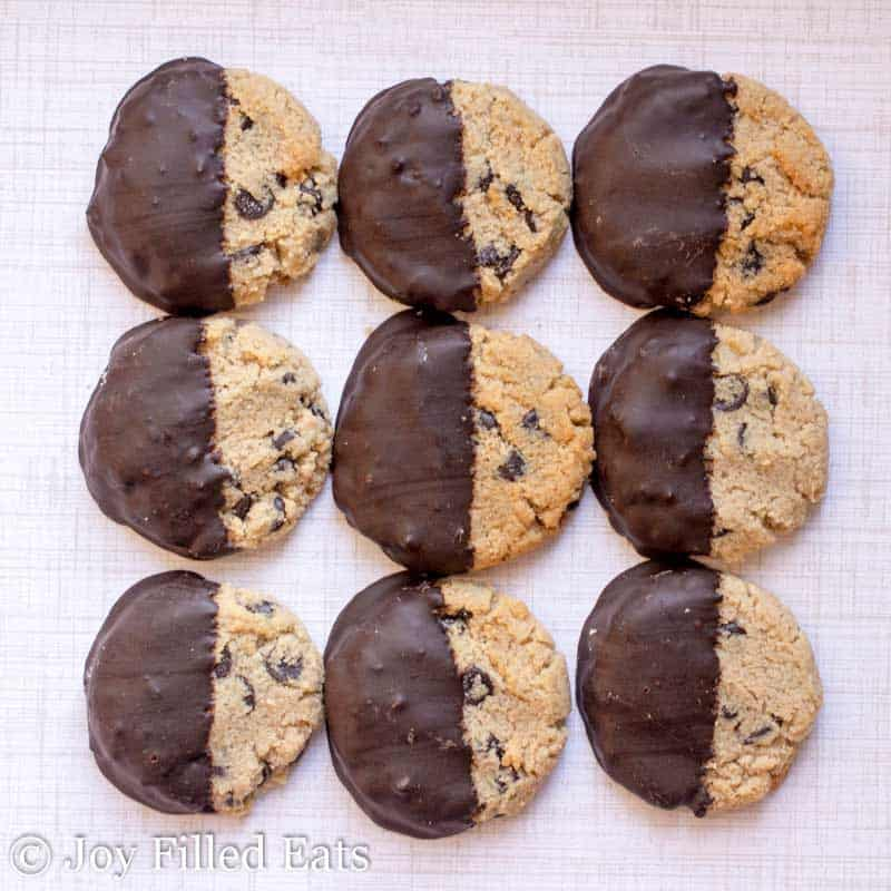 nine chocolate chip shortbread cookies arranged in a square all half dipped in chocolate
