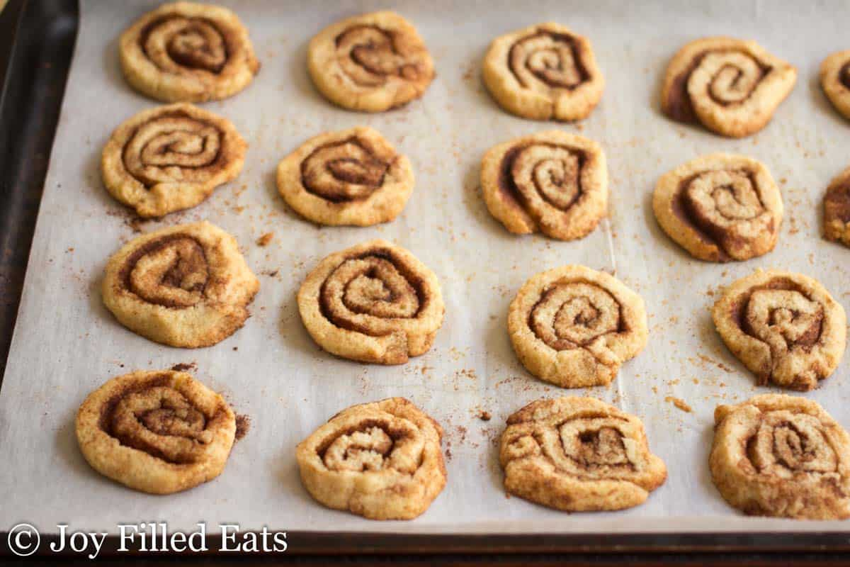 cinnamon roll cookies lined on parchment paper