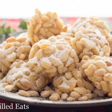 pile of pignoli cookies on a plate