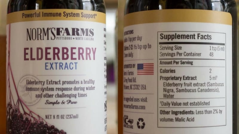 two bottles of Norm's Farms Elderberry extract with one bottle showing the supplement facts