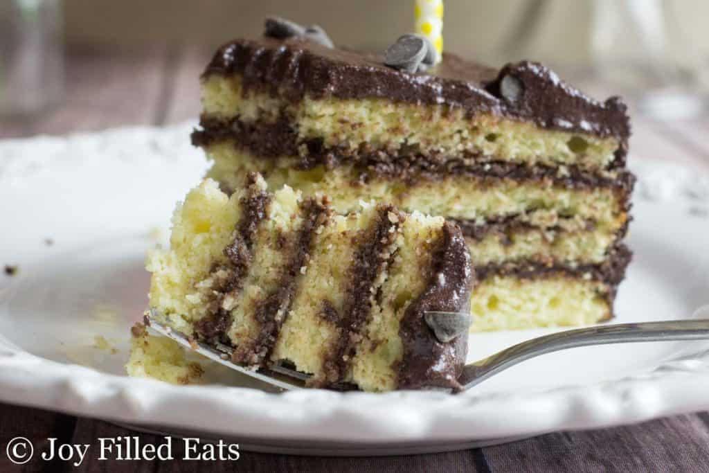 a bite of keto birthday cake with four layers on a fork