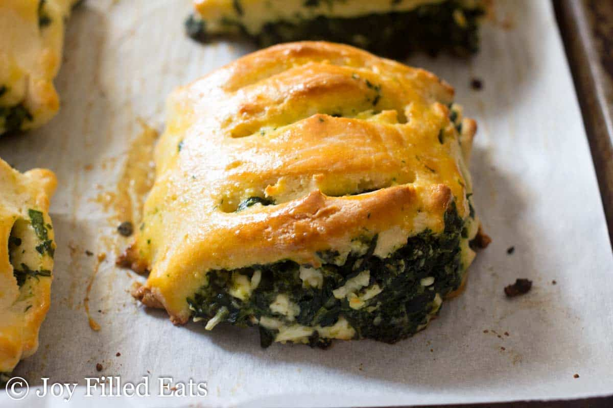 close up on a golden brown spinach and feta pastry