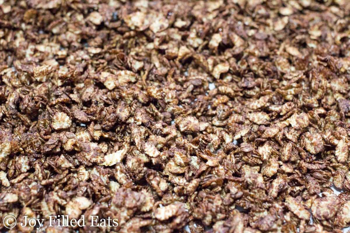 close up on copycat cocoa krispies spread onto sheet pan