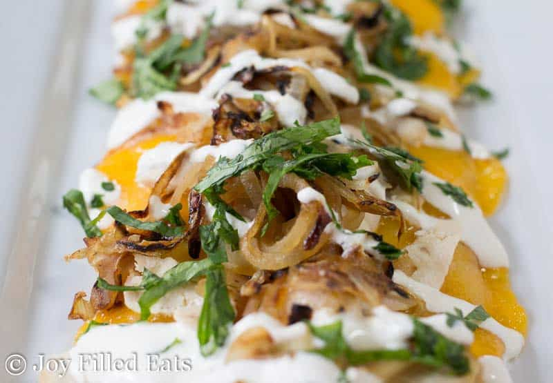 Close up of the toppings on the Zesty Chicken & Onion Low Carb Flatbread