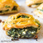 close up on keto spanakopita lined on parchment paper