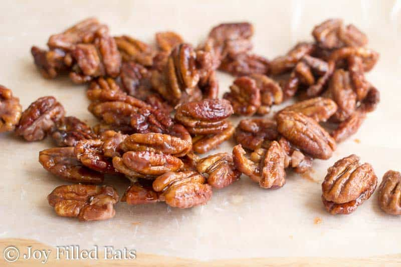 3 Ingredient Stovetop Glazed Pecans on a piece of waxed paper