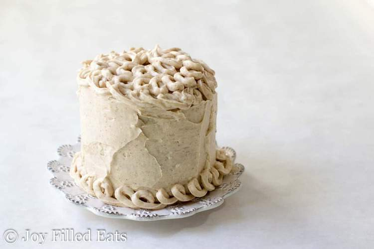 icing decorated mini snickerdoodle layer cake on a white plate