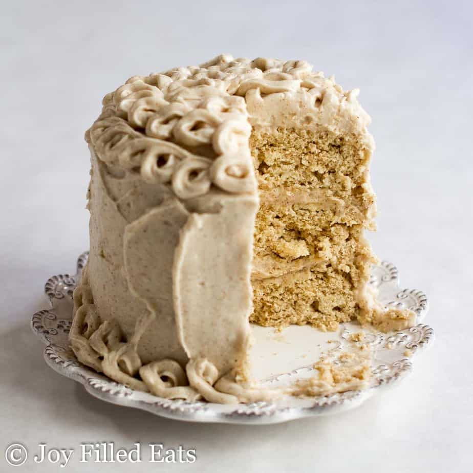 mini snickerdoodle layer cake with slice missing on a small white plate