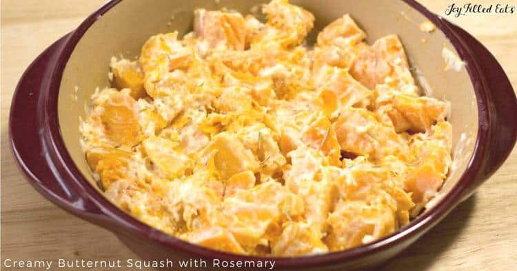 shallow casserole dish of creamy butternut squash with rosemary