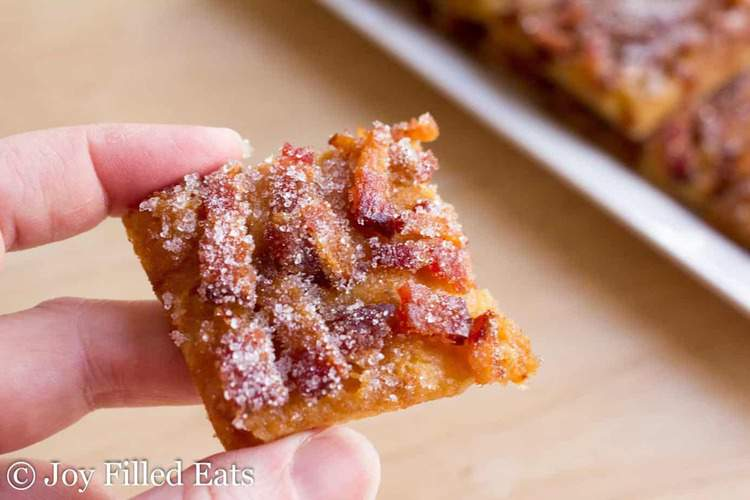 hand holding square of low carb maple bacon crack